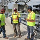 Director Jeff Dorn talks saftey vest fashions with Ironworkers.